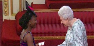 KUMBA MUSA RECEIVING AN AWARD FROM QUEEN ELIZABETH II AS A YOUNG LEADER